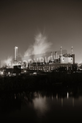 Canvas print Factory with chimney at night in Philadelphia.