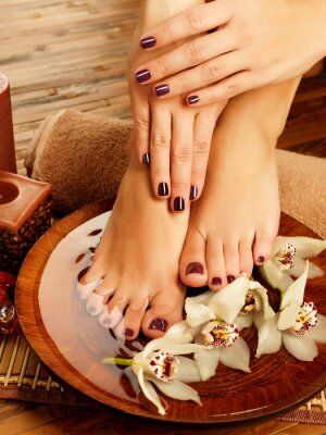 Canvas print female feet at spa salon on pedicure procedure