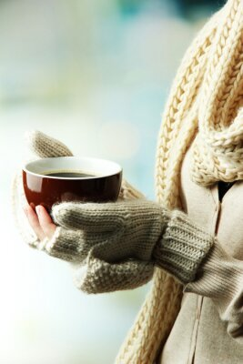 Canvas print Female hands with hot drink, on light background