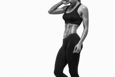 Canvas print Fitness sporty woman showing her well trained body