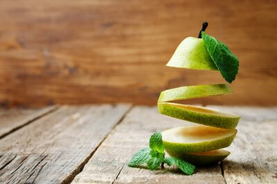 Canvas print flying slices of pear