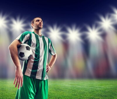 Canvas print Football-player with a ball