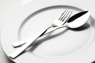 Canvas print fork and spoon on white plate