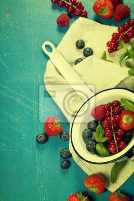 Canvas print Fresh Berries on Wooden Background. Strawberries, Raspberries an