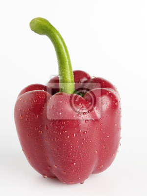 Fresh, red paprika with drops of water on white background