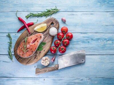 Canvas print Fresh salmon on the cutting board.