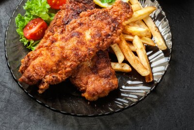 Canvas print Fried fish in crispy batter with chips