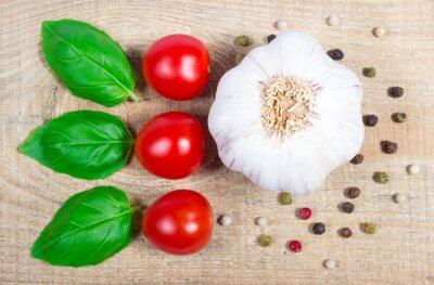 Canvas print Garlic, tomatoes and basil. Close Up.