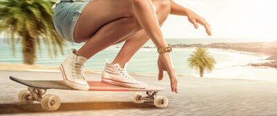 Canvas print Girl cruising with her longboard