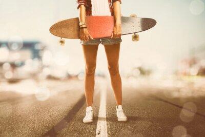 Canvas print Girl holds Longboard