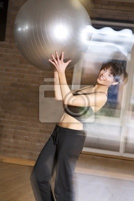 Girl Jumping with a fitball