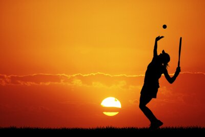 Canvas print girl playing tennis at sunset