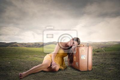 Girl sitting in a field