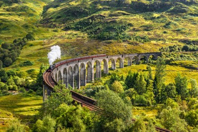 Canvas print Glenfinnan Railway Viaduct in Scotland with the Jacobite steam train passing over