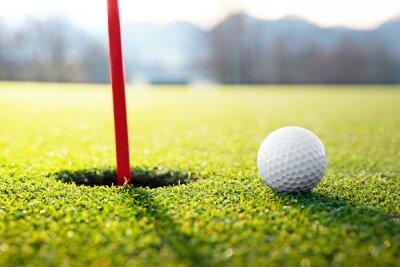 Canvas print golf ball near the hole