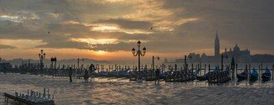 Canvas print Gondolas by Saint Mark square during sunrise with San Giorgio di Maggiore church in the background in Venice Italy
