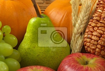 Green pear among other autumn fruits and vegetables