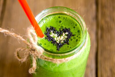 Canvas print Green smoothie with heart of seeds