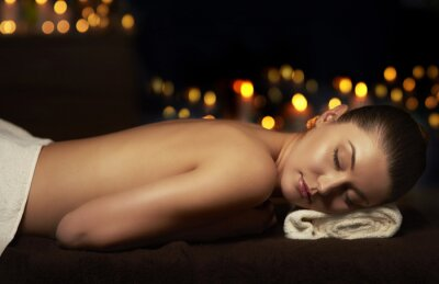 Canvas print Half naked woman resting after massage