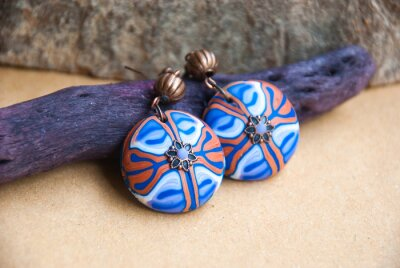 Handmade jewelry from polymer clay. Floral Ethnic earrings with unique pattern. Fashion jewelry.Still life in boho style. Trendy accessory.