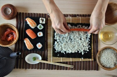 Canvas print hands cooking sushi