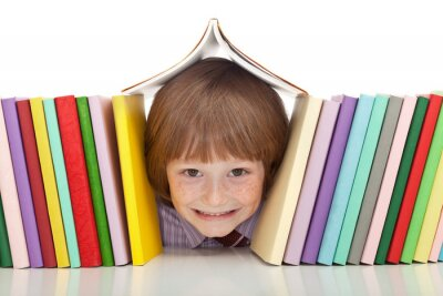 Canvas print Happy boy with colorful books