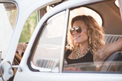 Canvas print Happy, carefree woman enjoy a retro car, hot summer day.