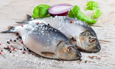 Canvas print Herring on a wooden background.