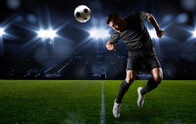 Canvas print Hispanic Soccer Player heading the ball