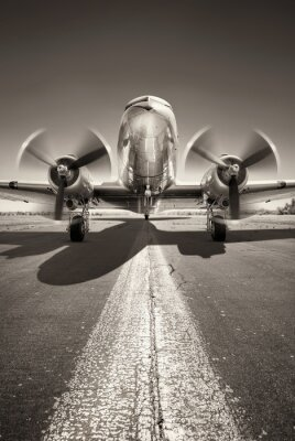 Canvas print historic aircraft is waiting for take off on a runway