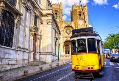 Canvas print Historical yellow tram in front of the Lisbon cathedral, Lisbon,
