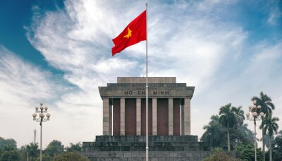 Canvas print Ho Chi Minh mausoleum in Hanoi with red communistic flag