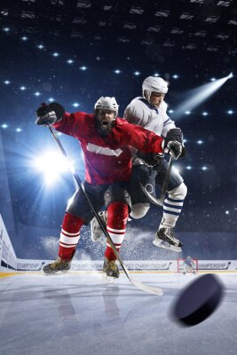 Canvas print Hockey players shoots the puck and attacks