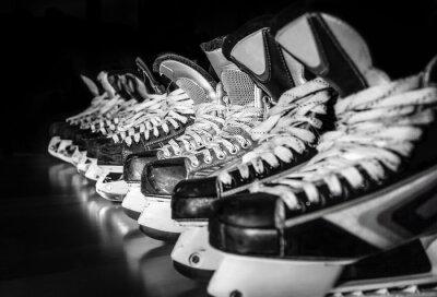 Canvas print Hockey skates lined up in locker room