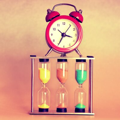 Canvas print hourglass and alarm clock