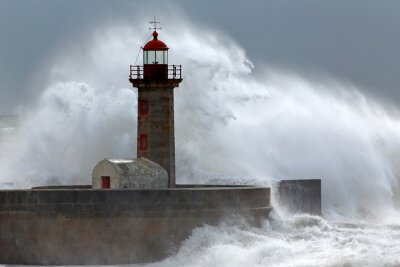 Canvas print Huge wave over lighthouse