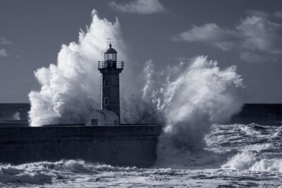 Canvas print Infrared old lighthouse under heavy storm