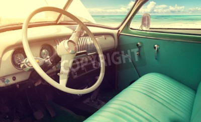 Canvas print Interior of classic vintage car -parked seaside in summer