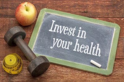 Canvas print Invest in your health advice on blackboard