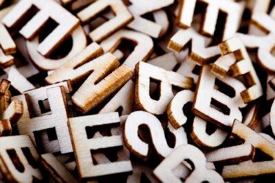 Canvas print Jumbled wooden letters close up