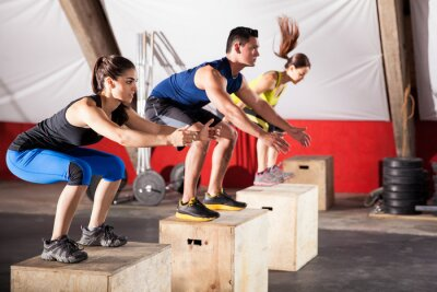 Canvas print Jumping exercises at a gym