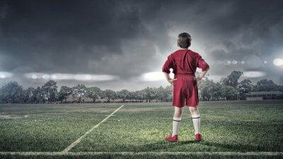 Canvas print kid boy on soccer field