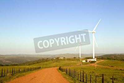 Large wind turbines set on a farm in beautiful scenery