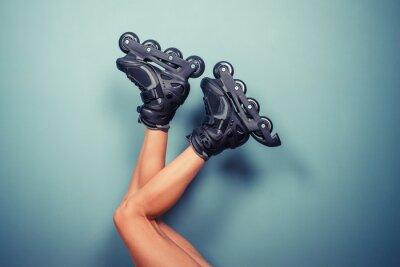 Canvas print Legs of woman wearing rollerblades