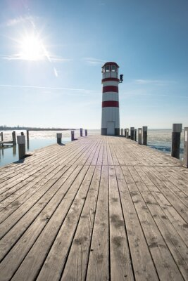 Canvas print Lighthouse at the end of the wooden pier. Podersdorf am see, Austria