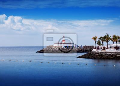 Lighthouse in sea coast