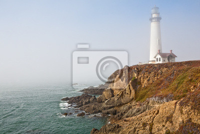 lighthouse in sea mist
