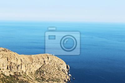 Lighthouse on sea background .Meganom, Crimea