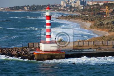 Lighthouse, stormy sea