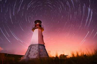 Canvas print lighthouse with night sky at background stars trails